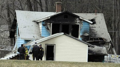 Aftermath of fire Authorities gather near the house that was the scene of fatal fire in Brockway.