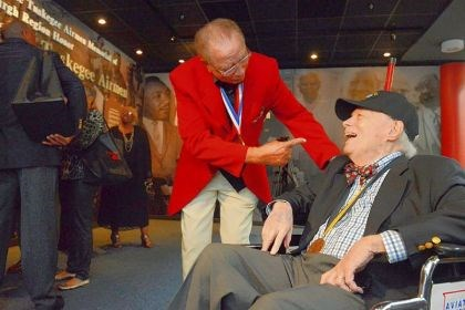 airmen1 Tuskegee Airman Robert Higginbotham, 87, left, of Palm Springs, Calif., and formerly of Sewickley, shares a laugh Thursday with Wendell Freeland, 88, of Shadyside at the Tuskegee Airmen Recognition Exhibit at Pittsburgh International Airport.