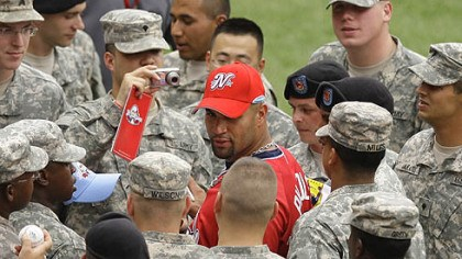 Albert Pujols Cardinals Albert Pujols of the St. Louis Cardinals signs autographs for military personnel before the game.
