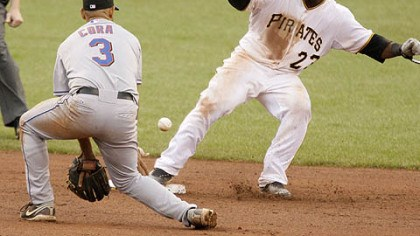Alex Cora and Robinzon Diaz Pirates catcher Robinzon Diaz, gets back to second safely as Mets shortstop Alex Cora gets in front of the pickoff throw from catcher Omir Santos during the eighth inning yesterday.