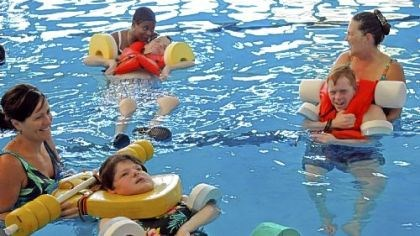 Allegheny Valley School Children at Allegheny Valley School in Robinson take part in Aquatic Therapy class. From left are Elizabeth Mink with client Carol Valecko; Tenieda Greene with client Danny Barcelona; and Chris Hurt with client Sean Malley. The late Myron Cope gave trademark rights for his Terrible Towel to the school. Royalties from sales are used to benefit the school.