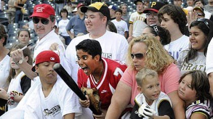Amal Chabra Amal Chabra, 12, of Sewickley, reacts after getting a bat from Pirates player Jack Wilson after the Pirates' last home game.
