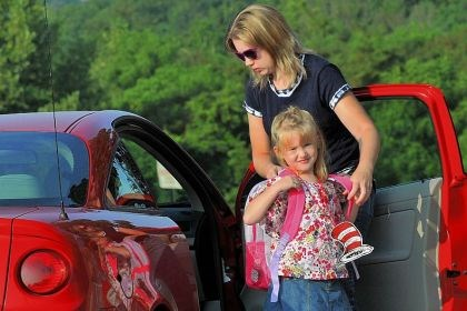 Amanda Krelic Amanda Krelic of Heidelberg helps her daughter, Hannah, 5, with her backpack as they arrive for the first day of kindergarten at Chartiers Valley Primary School last Thursday.