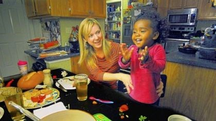 Amanda Szenyeri and her adopted daughter, Mae Amanda Szenyeri plays with her 20-month-old daughter Mae, an adoptee from Ethiopia, at their dinner table in Cranberry. Mae was adopted through All God's Children.