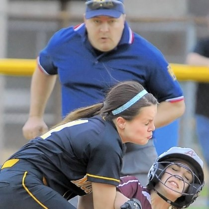 Ambridge Softball Ambridge's Hannah Krokonko slides under the tag by Montour shortstop Stacey Capp during a game last year.