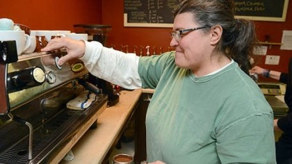 Amy Enrico makes espresso Amy Enrico makes espresso at Tazza D'Oro in Highland Park. The coffee shop owner, who has another location at Carnegie Mellon University, says keeping her business small helps her keep an eye on quality.