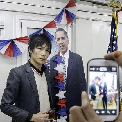 An Afghan youth An Afghan youth poses next to the cardboard cutout of President Barack Obama for a cell phone snapshot during a U.S. presidential election event at the U.S. embassy in Kabul, Afghanistan.
