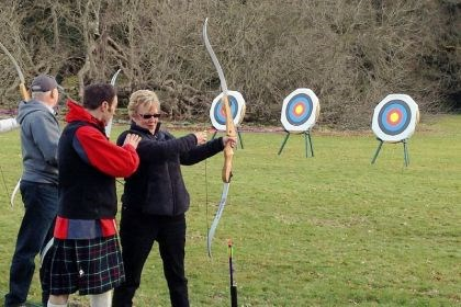 An archery lesson An archery lesson on the grounds of Glamis Castle is among the activities on the Adventures by Disney tour of Scotland.