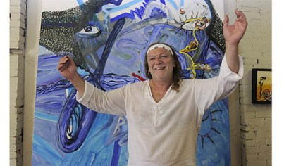"Anastas Konstantinov Bulgarian artist Anastas Konstantinov in front of ""Mackenzie's Smile"" at the Ice House Artist Studios in Lawrenceville."