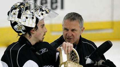 -Andre Fleury and coach Gilles Meloche Penguins goalie Marc-Andre Fleury, left, talks with coach Gilles Meloche during the hockey team's practice yesterday at the Mellon Arena in preparation for tonight's game.