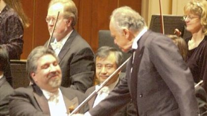 Andres Cardenes and Lorin Maazel At a December 2000 concert in Heinz Hall, Mr. Cardenes greets conductor Lorin Maazel, who was instrumental in his career.