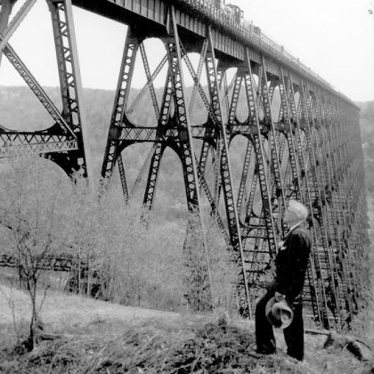 Andrew Kinzua Stauffer Andrew Kinzua Stauffer watches as the final sightseeing train rumbles over Kinzua Viaduct on May 18, 1958. He and his father, Charles, were railroad bridge inspectors.