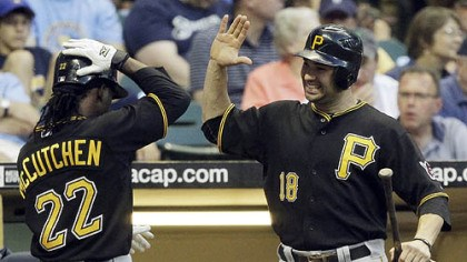 Andrew McCutchen and Neil Walker The Pirates' Andrew McCutchen is congratulated by Neil Walker after McCutchen hit a home run during the fifth inning.