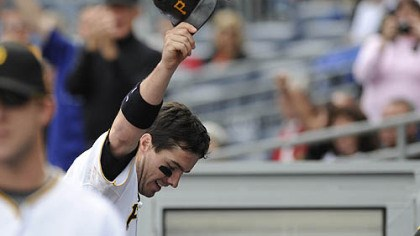 Andy LaRoche Pirates third baseman Andy LaRoche raises his helmet after a two-run home run in the bottom of the eighth inning.