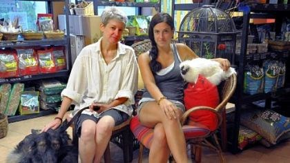Animal Nature Nina Wolf and Rachel Lamory, owners of Animal Nature, with Odin, a king shepherd, and Q-Tip, a silkie rooster.