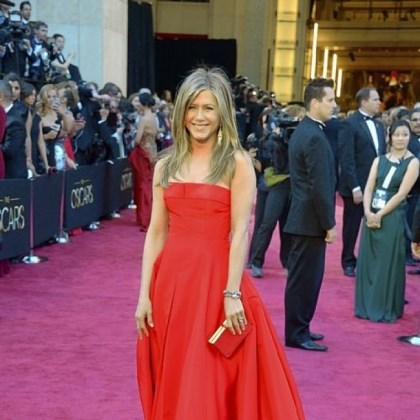 Aniston on red carpet Jennifer Aniston chose a fiery red dress for the Oscars.