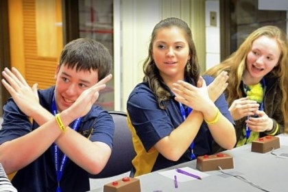 "Answer X Norwin High School students, from left, Sam Bartuska, Lindsey Robinson and Alexis Boytim signal an answer ""x"" to their teammate Sarah Kerr (not pictured) during the practice round in the Southwestern Pennsylvania Science Bowl at the South Campus of CCAC on Saturday."