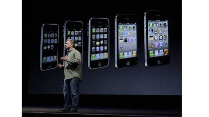 apple unveils iphone Phil Schiller, Apple's senior vice president of worldwide marketing, speaks on stage during an introduction of the new iPhone 5 at an Apple event in San Francisco today.