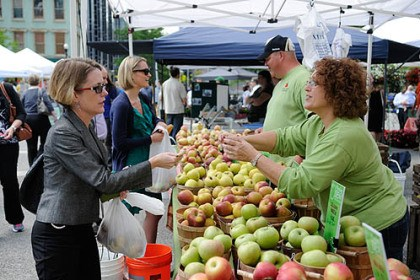 apples purchased Tracy DeCock, left, of Upper St. Clair, purchases apples from the Morning Dew Orchards booth at the Market Square farmers market today.