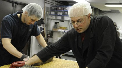 April April: Operations manager Conor Foley helps production manager Greg Muckle with a batch of almond butter toffee at the Edward Marc Chocolatier shop in Trafford.