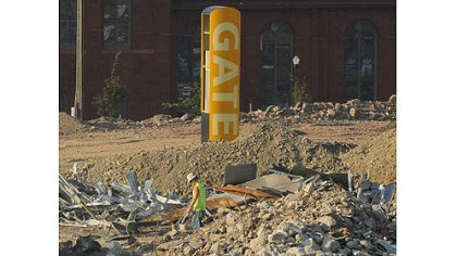 Arena 3 Signage for a gate of the Civic Arena stands alone during demolition operations.