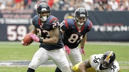 Arian Foster The Texans' Arian Foster (23) breaks away from Steelers outside linebacker LaMarr Woodley Sunday.