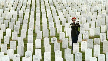 "Arlington National Cemetery Sgt. 1st Class James MacKenzie plays ""Taps"" during the funeral of Army Ranger Capt. Russell B. Rippetoe at Arlington National Cemetery in April, 2003. Rippetoe, 27, from Arvada, Colo., was the first soldier from the Iraqi conflict to be laid to rest at Arlinton."