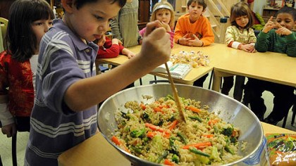 Asher King Kindergartner Asher King works on a stir-fry at the Kentucky Avenue School in Shadyside last week.