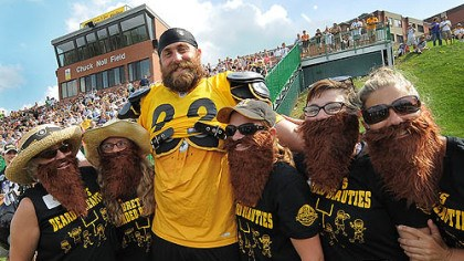 "August August: Steelers defensive end Brett Keisel poses with ""Brett's Bearded Beauties"" at training camp."