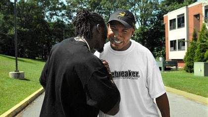 Back at camp Hines Ward greets Santonio Holmes as they arrive at St. Vincent College for the start of training camp.