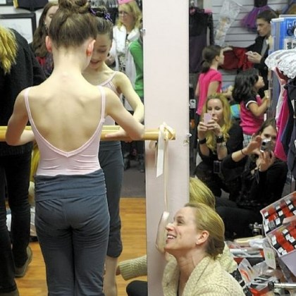 Ballet School students Pittsburgh Ballet School principal Anastasia Wovchko helps fit one of her students, Gianna Christensen, 10, of Pine with her first pointe shoes at The Dancer's Pointe in the Strip District.