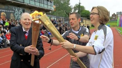 Bannister torch Before heading to Windsor Castle, the torch is passed from honorary torchbearer Sir Roger Bannister, left, to Nicole Byrom at Iffley Road Stadium in Oxford. Bannister was the first man to break the 4-minute mile, doing so at the stadium 58 years ago.