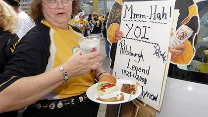 "Barbara Cord Steelers' fan Barbara Cord, of Baldwin Borough, outside Heinz Field on Sunday, is a veteran tailgater, having begun her ""career"" in 1959 when the team played at Pitt Stadium. Her friends says she makes the best haluska. The Myron Cope cardboard standup belongs to friend."