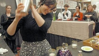 Barista competes Dana Waelde of the Crazy Mocha in Oakland gets a reaction from the audience yesterday as she shakes her signature drink, Cafe Cioccolato, for the panel of judges at a regional barista competition at the Pittsburgh Marriott North in Cranberry.
