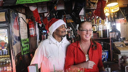 Bartending at Jack's Glen Frazier, left, a bartender at Jack's Bar at 1117 East Carson St. in the South Side, clowns with bartender Adrian Szymczak as they face the early crowd on Christmas Day.