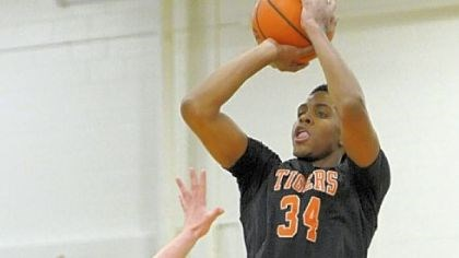 basketball Beaver Falls High School junior Sheldon Jeter puts up a 3-point attempt in a non-section game against rival Blackhawk earlier this month. Jeter missed the first 11 game with a broken bone in his left hand.