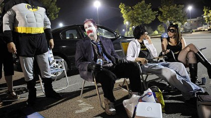 "Batman tailgating Keith Pfender, of Washington, David Kirik, of Brentwood, Elliott Stone, 16, of Mt. Lebanon, and Megan Kirik, 16, of Brentwood, tailgate in front of Loews Theatres at the Waterfront before the opening of the new Batman movie, ""The Dark Knight,"" last night."