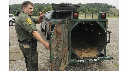 Bear trap State wildlife conservation Officer Matt Kramer shows a bear trap that had been set Monday near the Pittsburgh Mills mall in Frazer.
