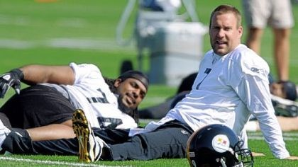 Ben Roethlisberger and Willie Colon Pittsburgh Steelers quarterback Ben Roethlisberger stretches with tackle Willie Colon before the first day of mandatory off-season workouts.