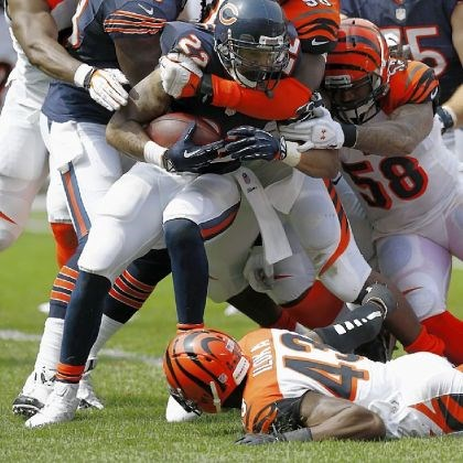 bengals2 Bengals defensive end Carlos Dunlap and linebacker Rey Maualuga tackle Bears running back Matt Forte Sunday in Chicago.