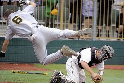 Bergstrom North Allegheny's Brandon Bergstrom avoids the tag of Seneca Valley catcher Brad Gresock to score the winning run in the 10th inning of the PIAA Class AAAA quarterfinal Friday at Pullman Park in Butler.