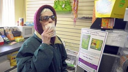 Beverly Joyce Beverly Joyce, 70, of Bloomfield kisses her Mega Millions lottery ticket for luck as they are being snapped up Thursday afternoon at Bella's News in Bloomfield as the winning amount reaches $540 million.