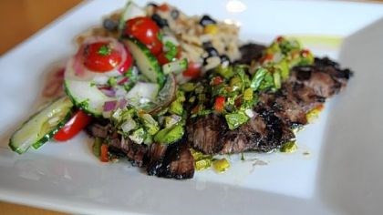 Bife steak Bife steak chimichurri con gallo pinto (Argentina): Grilled marinated skirt steak topped with chimichurri with black beans and rice created by Chef Martin Lamarche, Alma, a new Pan-Latin American restaurant in Regent Square.