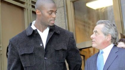 Big and bad The Giants' Plaxico Burress, accompanied by his lawyer Benjamin Brafman, leaves Manhattan Supreme Court yesterday after his arraignment on weapons possession charges stemming from an incident at a Manhattan nightclub Friday.