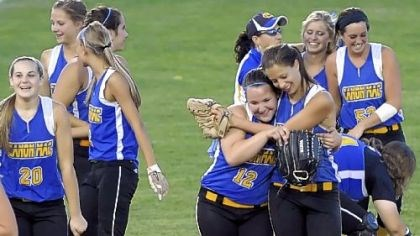 Big Macs Softball Canon-McMillan teammates celebrate their WPIAL title game victory against Hempfield on May 31.