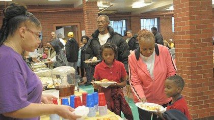 bigmeal Residents take part in a community dinner Saturday at the Warrington Recreation Center.