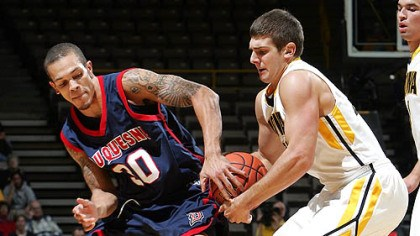 "Bill Clark Duquesne guard Bill Clark on the Dukes' defense: ""We have been a tougher team."""