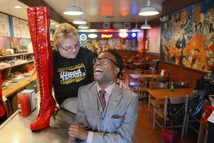 "Billy Porter sandwich Billy Porter, the Tony award winning CMU alumni and East Liberty native, poses with Strip District Primanti Bros. chef Toni Haggerty and a boot from ""Kinky Boots,"" the show for which he won his Tony."