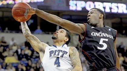 Blocked shot Cincinnati's Justin Jackson blocks a shot by Pitt's John Johnson in the second half Sunday night at Petersen Events Center.