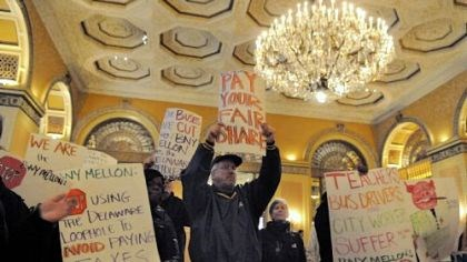 BNY Mellon's shareholder meeting One Pittsburgh protesters chant in the lobby of the Omni William Penn during the BNY Mellon's shareholder meeting Tuesday.